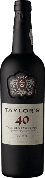 The Tawny 40 Years Old from Taylor's Port is the result of an extraordinarily intense and varied enjoyment. This Port combines the grape varieties Tinta Amarela, Touriga Nacional, Touriga Francesa, Tinta Barocca, Tinta Roriz and Tinta Cao. Due to the very long barrel aging of 40 years, this port shimmers in a warm mahogany brown with greenish edge shades. The nose is spoiled by a sweet, spicy aroma - freshly ground coffee unfolds with dried fruit and orange peels. On the palate, this port wine gains caramelized notes, accompanied by fine orange jam. With enormous power the palate is wonderfully taken by this wine. The tannins are perfectly interwoven and still clearly perceptible even after the long ripening period. In addition to the wonderful sweetness, this port has an incomparable freshness. The finale has a great length and a spicy finish of coffee and liquorice. Vinification of Taylor's Port Tawny 40 Years old Matured Tawny with age indication requires first of all the art of blending and wise foresight on the evolution of the wine during its long maturing period in the barrel. Each Tawny is composed from the beginning for its specific age: 10, 20, 30 or 40 years and must always have its characteristic style and taste. Even if this port is always composed from different wines and vintages. The grapes for this wine are harvested exclusively by hand and brought to the Taylor's Port cellar, where they are destemmed and fermented in open stainless steel tanks. As soon as half of the sugar is fermented, the fermentation process is stopped by adding high-proof distillate. This preserves the natural residual sweetness of this wine. Finally, this port wine matures for 40 years in wooden barrels until it is bottled. Food recommendation for the 40 Years Old Taylor's Tawny Enjoy this port with pleasure simply only pure and let yourself be spoiled by the facet wealth simply only. Or serve this wine with desserts with nut brittle and caramel or with mature cheeses (pecorin