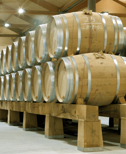 Barrels in the wine cellar of Aster