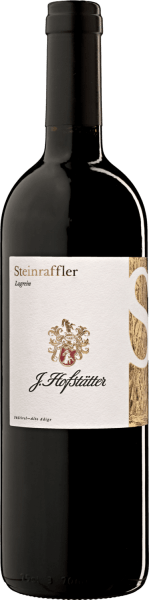 The Vigna Steinraffler Lagrein Alto Adige DOC by J.Hofstätter has a deep dark and garnet red colour with an almost black core in the glass. On the nose it surprises with a complex bouquet with earthy, fruity and spicy aromas, which at first develop softly and then more and more concentrated and finally remind of dark, ripe plums, dense and at the same time almost rustic. On the palate this complex and spicy aroma continues, with a powerful structure and well integrated tannins. The finish is long, persistent and shows a mineral component in the finish. Vinification of the Vigna Steinraffler Lagrein Alto Adige by J.Hofstätter Lagrein is a unique autochthonous grape variety that grows only in South Tyrol and finds optimal conditions in the Steinraffler vineyards of the J. Hofstätter Estate. The vines grow on clay and gravel soils. After manual harvesting, the grapes are destemmed and then put into the fermentation tank, where the mash is fermented for about 10 days after a short maceration. The wine is then aged for 15 months in small oak barrels and for another 7 months in large oak barrels. After bottling, it matures in the bottle for another 12 months before it is put on sale. In the Steinraffler vineyards, J. Hofstätter has planted the almost forgotten grape variety Lagrein with short stems, then grafted it on weak-growing rootstocks and cultivated them. Thus an old, indigenous grape variety could be revived. By cultivating the old grape variety with modern methods of cultivation, tradition and innovation were able to enter into a new connection. Food pairing for the VIgna Steinraffler Lagrein Alto Adige by J.Hofstätter Enjoy this exquisite Lagrein with red meats, game and mild cheeses. Awards for the Vigna Steinraffler Lagrein Alto Adige by J.Hofstätter Robert M.Parker: 92 points for 2008, 91 points for 2006 Wine Spectator: 91 points for 2008, 90 points for 2001