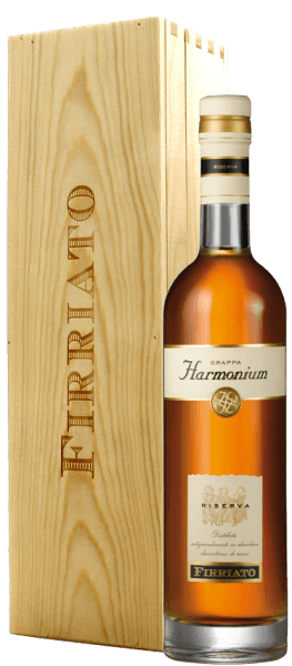 """This unique soft grappa is made from the pomace of the award-winning Nero d'Avola """"Harmonium"""". The Grappa Riserva Firriato Harmonium exhales aromatic fragrance with hints of vanilla, plum, almond and clove, which is complemented by pleasant smoky notes. In a wine glass or snifter of grappa can enjoy best as he can so develop its full flavor. Data of Grappa Riserva Harmonium in gift pack of Firriato Winery: Firriato Country: Italy Region: Sicily Content: 0,5 l Alcohol content: 43,00 Vol % Optimum serving temperature: 18 ° C"""