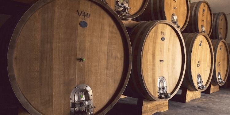Large wooden barrels in the Poggiotondo wine cellar